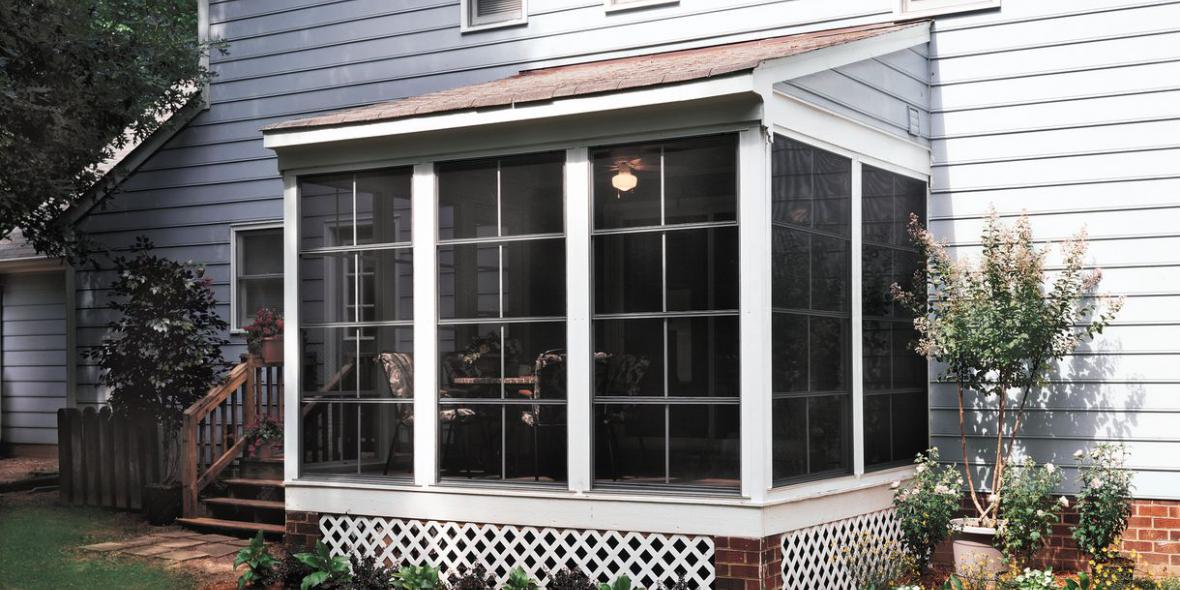 Outside view of a screen room built by Backyard Paradise Inc.