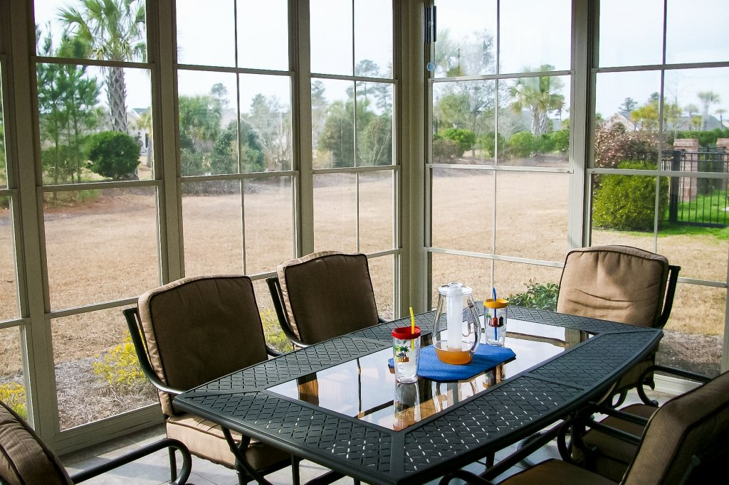 Interior view of a sun room by Backyard Paradise.