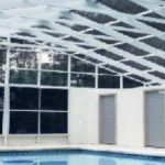 Phifer Screen pool enclosure with large swimming pool.