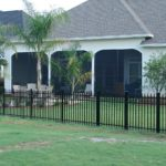 Gulf Coast home with a screen wall installed by Backyard Paradise Inc.