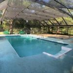 A new pool enclosure by Backyard Paradise Inc.