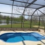 Gulf Coast pool enclosure by Backyard Paradise Inc.