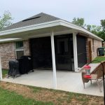 New screen room on a little brick house built by Gulf Coast Outdoor Living Specialists Backyard Paradise Inc.
